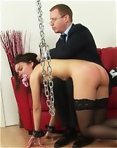 Office babe in the chains and with a gag